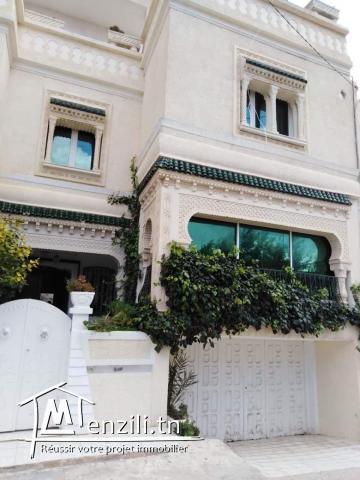 Une villa au rez-de-chaussée et deux appartements au 1 étage