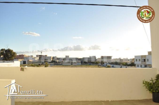 maison avec garage en plein centre ville à Korba