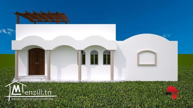 maison style arabesque en cours de construction et vue sur mer